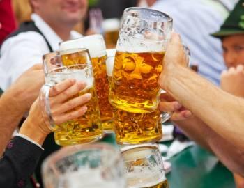 Friends cheers beers at Oktoberfest