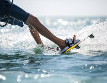 A person enjoys water-sports at the Shark Wake Park