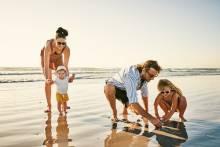 A family enjoy a day on the beach