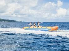 A family enjoys time on a banana boat