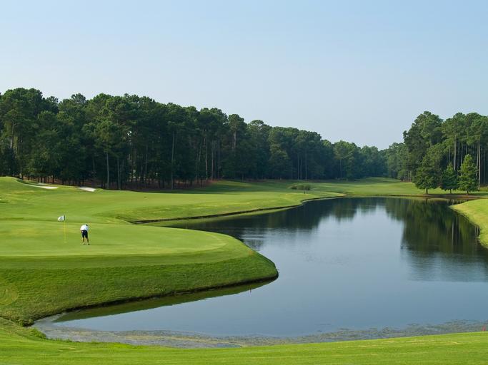 A golfer stands on a Myrtle Beach golf course